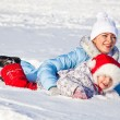 Mother and daughter in winter park — Stock Photo #4272531