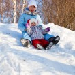 Mother and daughter in winter park - Stock Photo