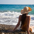 A woman is looking to the sea - Stock Photo
