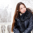 A woman is in the winter park — Stock Photo #4401556