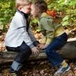A girl and a boy are playing hide-and-seek — Stock Photo