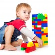 A funny boy is playing with lego — Stock Photo #4743256