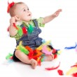 Little boy in colorful bright feathers — Stock Photo #4743262
