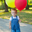 A boy with colorful baloons — Stock Photo