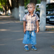 A contracted boy lost in the street — Stock Photo