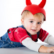 A funny boy in a hat with horns — Stockfoto