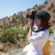 Stock Photo: Womis photographing nature