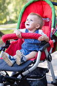 A baby is crying in the pram — Stock Photo