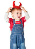 Upset boy in a red cap with horns is crying — Stock Photo