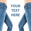 Female legs in a blue jeans — Stock Photo