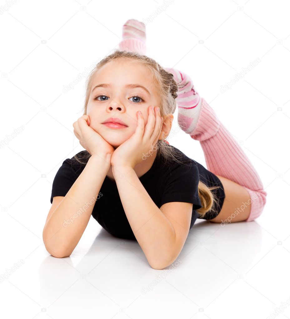 A cute girl is engaged in acrobatics  Stock Photo #5051782
