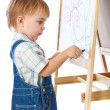 A boy is drawing on a blackboard. Isolated on a white background - Stock Photo