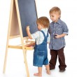Boys are drawing on a blackboard — Stock Photo #5185327