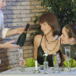 Waiter showing a bottle champagne — Stockfoto
