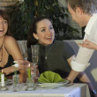 Stock Photo: Mflirting with two women