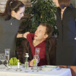 Jealousy scene in restaurant - Stock Photo