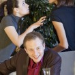 Stock Photo: Happy man between quarreling women