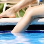 Legs in swimming pool — Stock Photo #2857972
