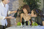 Waiter showing a bottle champagne — Stock Photo