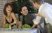 Man flirting with two women — Stock Photo