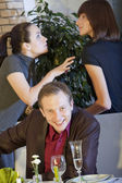 Happy man between quarreling women — Stock Photo