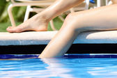 Legs in swimming pool — Stock Photo