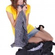 Sad woman packing clothes — Stock Photo