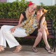 Two female friends on the bench — Stock Photo