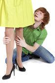 Crying man holding woman legs — Stock Photo