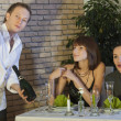 Waiter presenting champagne — Stock Photo