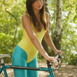 Girl with bike - Stock Photo