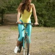 Active woman cycling - Stock Photo