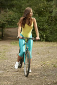 Active woman cycling — Stock Photo