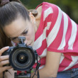 Female Photographer making shot — Stock Photo