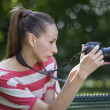 Woman takes picture — Stock Photo