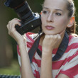 Woman with photo camera — Stock Photo