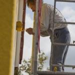 Painter on scaffold — Stock Photo