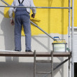 Foto Stock: Painter on scaffold