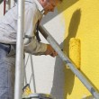 Painter with roller working — Stock Photo