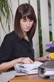 Female accountant with documents — Stock Photo