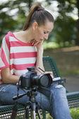 Female Photographer making notice — Stock Photo
