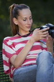 Woman photographer checking pictures — Stock Photo