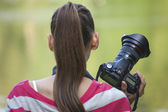 Female Photographer with camera — Stock Photo