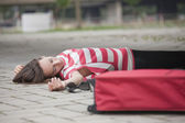 Unconscious woman on asphalt road — Stock Photo
