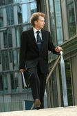 Businessman walking — Stock Photo