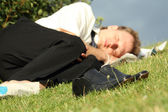 Businessman sleeping in park — Stock Photo
