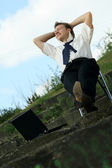 Relaxing businessman outdoors — Stock Photo