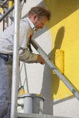 Painter with roller working — ストック写真