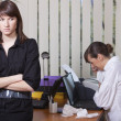 Woman crying in office — Stock Photo
