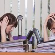 Stock Photo: Frustrated businesswomen by work